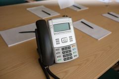 Phone on table in meeting room Royalty Free Stock Image