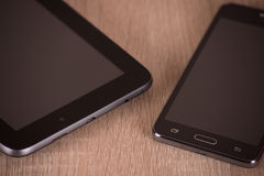 Phone and tablet. On a board Stock Images