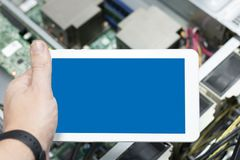 Phone or tablet on hand at server equipment background. administering computer`s local server. Diagnostic for server health. secu. Rity and cloud technology stock photo