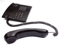 Phone with the taken off tube. Black phone with the taken off tube on a white background is isolated Stock Photo