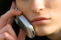 Phone talk. Sexy young lady talking on the phone Royalty Free Stock Photos