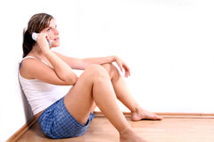 Phone talk. A young woman is chatting on the phone in her apartment Royalty Free Stock Photography