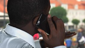 Phone talk in the street. stock footage