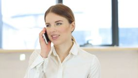Phone Talk, Woman in Office Royalty Free Stock Photography