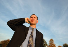 Phone talking. Businessman talking in the city park Royalty Free Stock Photos
