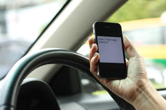 Phone, Texting and driving, dangerous. Texting and driving is dangerous and no unsafe Royalty Free Stock Photos