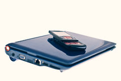 Phone on top of laptop Royalty Free Stock Photo