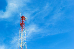 Phone tower antenna with Cloud and blue sky background Royalty Free Stock Photo