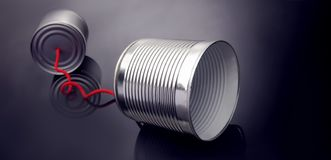 Phone toy from a tin can lying on a smooth black polished table.  royalty free stock image