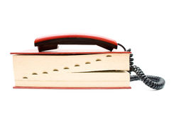 Phone tube with dictionary Stock Image