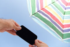 With Phone Under Beach Umbrella Royalty Free Stock Photo