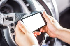 Phone is used in a car Stock Image