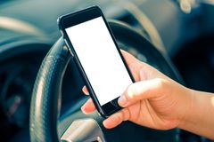 Phone is used in a car Royalty Free Stock Photos
