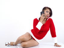 On the phone wearing Christmas uniform Royalty Free Stock Images