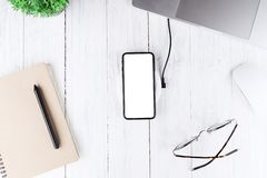 Phone white blank screen on wireless charger top view stock images