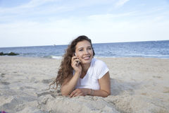 On the phone. Woman speaking on a cell phone Royalty Free Stock Photos