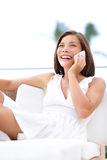 Phone woman talking on smartphone - on sofa Royalty Free Stock Image