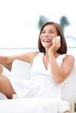 Phone woman talking on smartphone - on sofa royalty free stock image