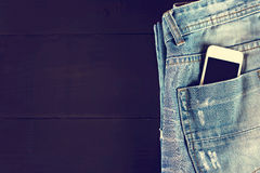 Phone in your pocket jeans Stock Images
