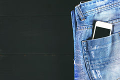 Phone in your pocket jeans Royalty Free Stock Photos