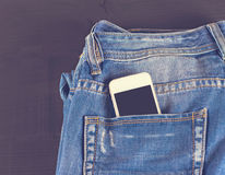 Phone in your pocket jeans Stock Photo