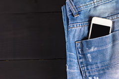 Phone in your pocket jeans Royalty Free Stock Image