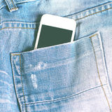 Phone in your pocket jeans Stock Image
