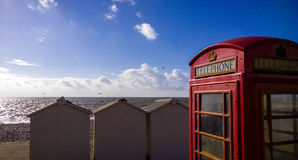 Phonebox GPO exmouth. BT GPO red telephone box on a beach, public use call payphone Taken OCT 2014 on exmouth beach, devon, uk Stock Photo
