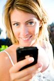 Phonecall. Young woman with a mobile having call Stock Image