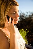 Phonecall. Young woman with a mobile having call Stock Photos
