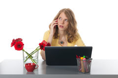 Phonecall at the office. Young woman is heaving a phonecall with mobile phone Stock Images