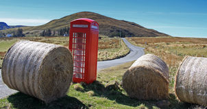 Phonecall from Scotland. Photo of a typical british phonebooth in a remote part of  the Highlands Stock Photo