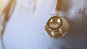 Phonendoscope in doctor arm Royalty Free Stock Photos