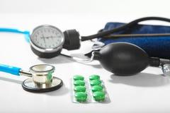 Phonendoscope and pill Stock Photos