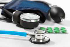 Phonendoscope and pill Stock Photo