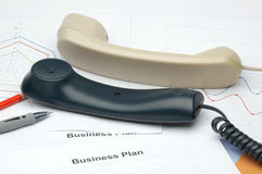 Phones on business files Stock Photography