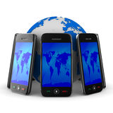 Phones and globe on white background Royalty Free Stock Photo