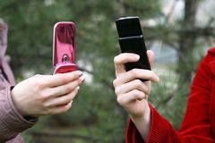 Phones in hands. Stylish mobile phones in female hands Royalty Free Stock Photography