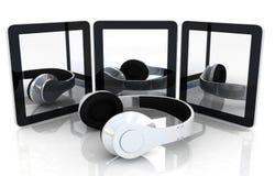 Phones and headphones Stock Photos