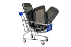 Phones in shopping cart stock photography