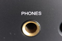 Phones socket on amplifier. Close up of labelled phones socket on integrated stereo amplifier Stock Photo