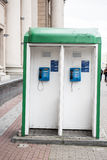 Phones in a telephone booth Royalty Free Stock Photo