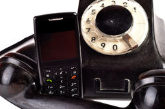 Phones Yesterday and Today. Photo of modern phone and old phone compared with themselves royalty free stock image