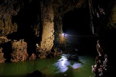 Phong Nha Ke national park / Vietnam, 16/11/2017: Group ziplining over an underground river inside the giant Hang Tien cave in the stock images