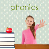 Phonics against red apple on pile of books Royalty Free Stock Photography