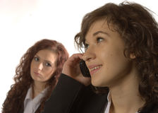 Phoning. A young woman is phoning Stock Photos