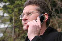 Phoning. Man telephoning with a handy Stock Photo