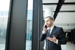 Phoning in airport royalty free stock images