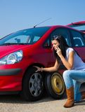 Phoning for car breakdown help. Closeup of teenager telephoning for help with roadside car breakdown Stock Image