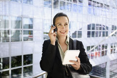 Phoning in an elevator Stock Images